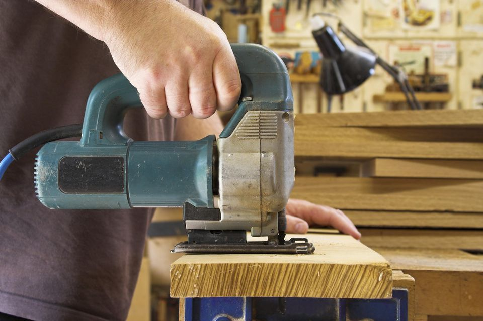 Woodworker Using An Electric Jigsaw