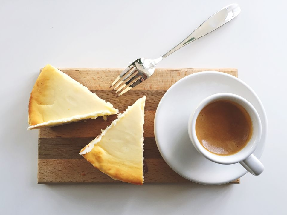 two slices cheesecake with coffee