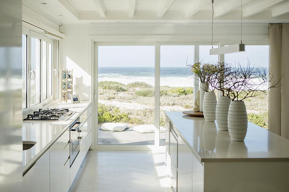 Modern white kitchen with ocean view