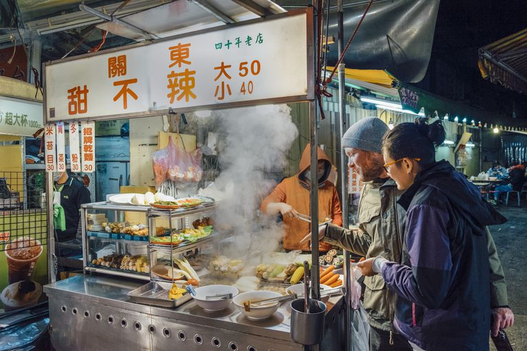 couple buying food at Chinese food stand
