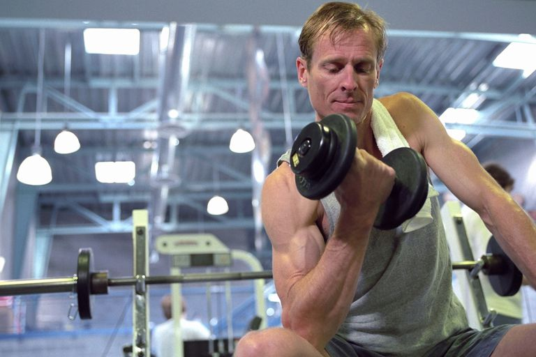 Man doing a dumbbell concentration curl.