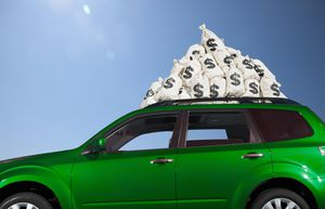$ money bags piled on car roof