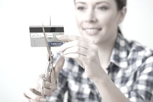 A woman cuts up a credit card