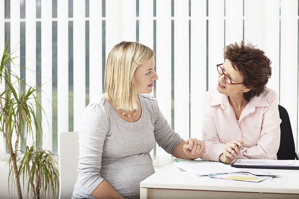 A picture of a pregnant woman getting advice