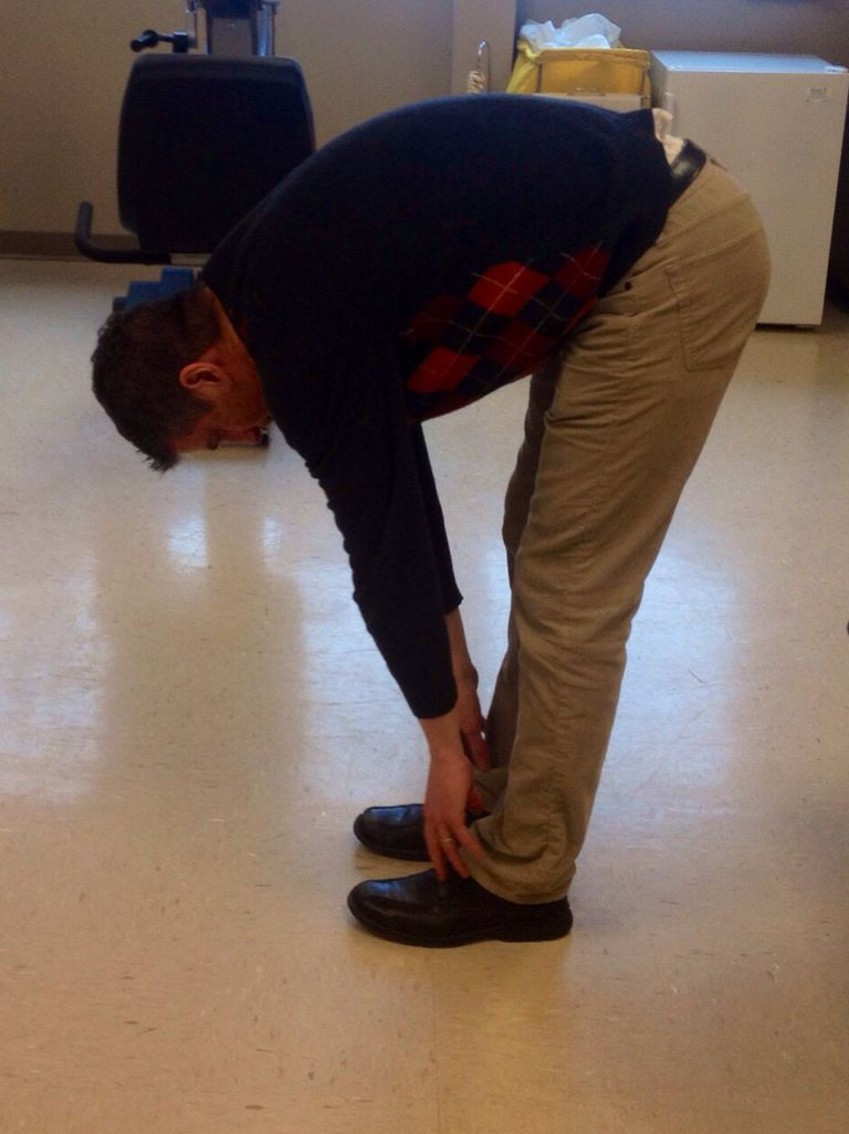 Lumbar flexion in standing.