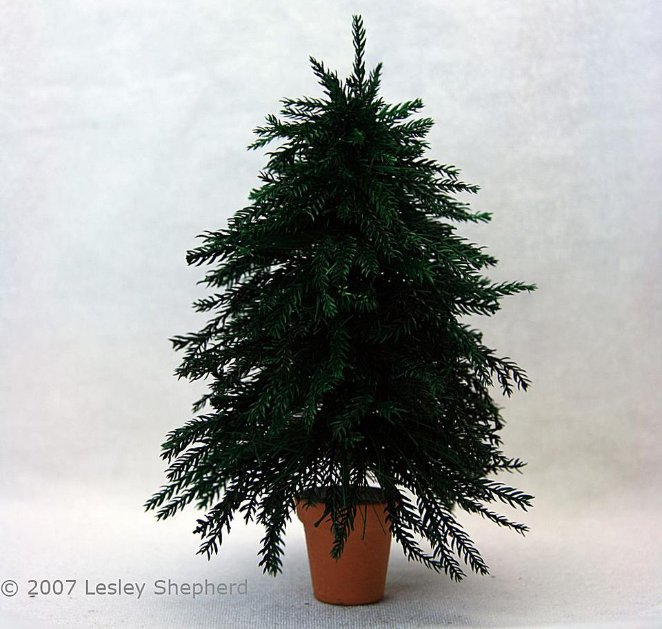 Six inch high miniature Christmas tree with realistic branches.