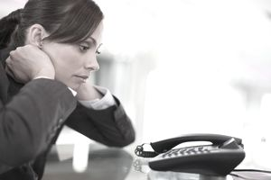 businesswoman waiting by phone