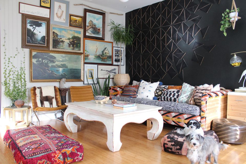 Black geometric accent wall and gallery wall