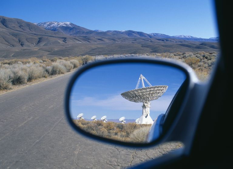 satellite in side-mirror of car