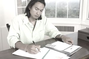 Man Working With Calendar