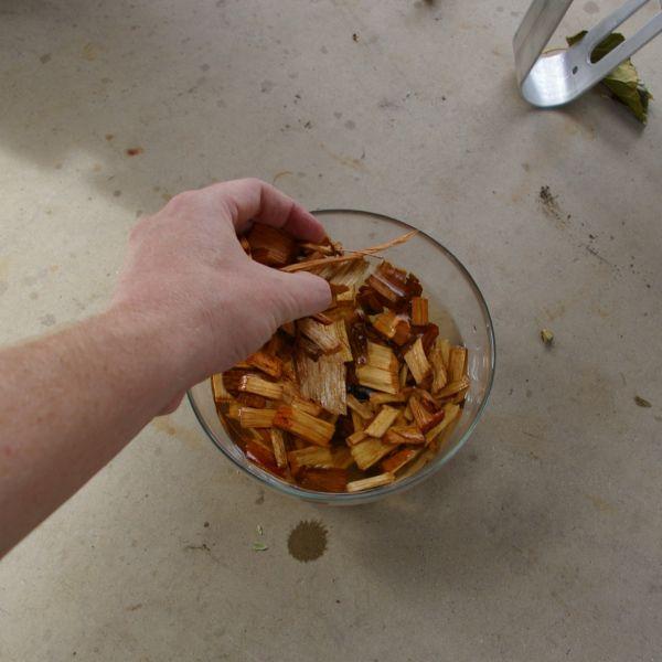 Adding Wood Chips - Smoking Turkey