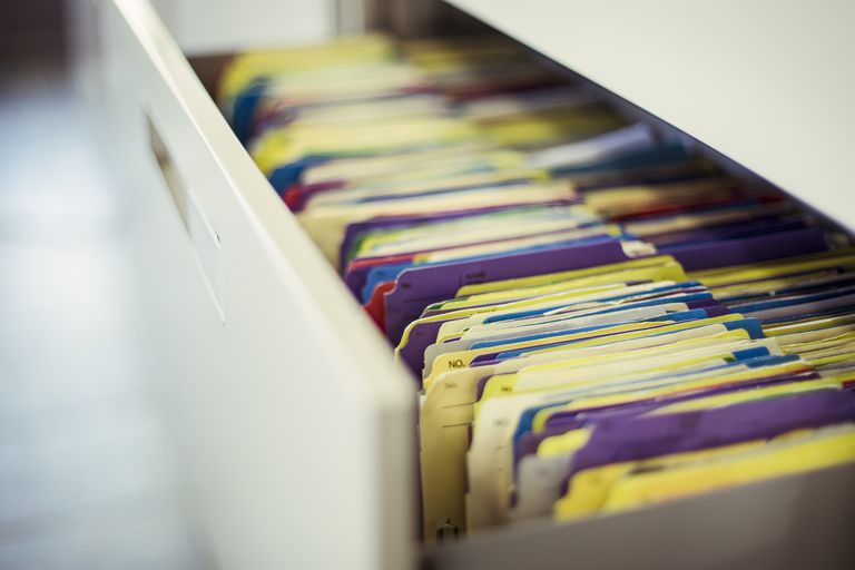 colorful files in a drawer