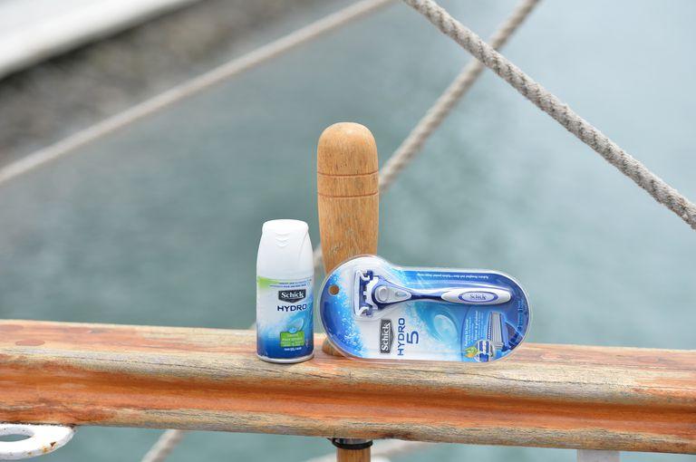 Hydro 5 razor and shave cream sitting on a railing