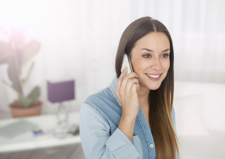 Young woman with mobile phone, smiling