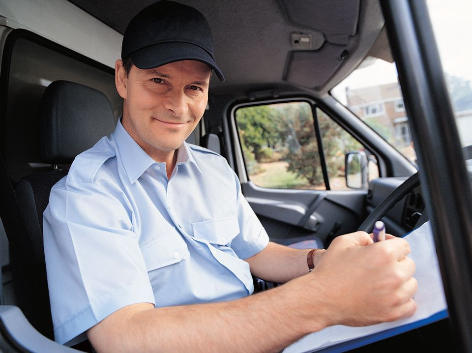 Mover sitting in his truck working on documents