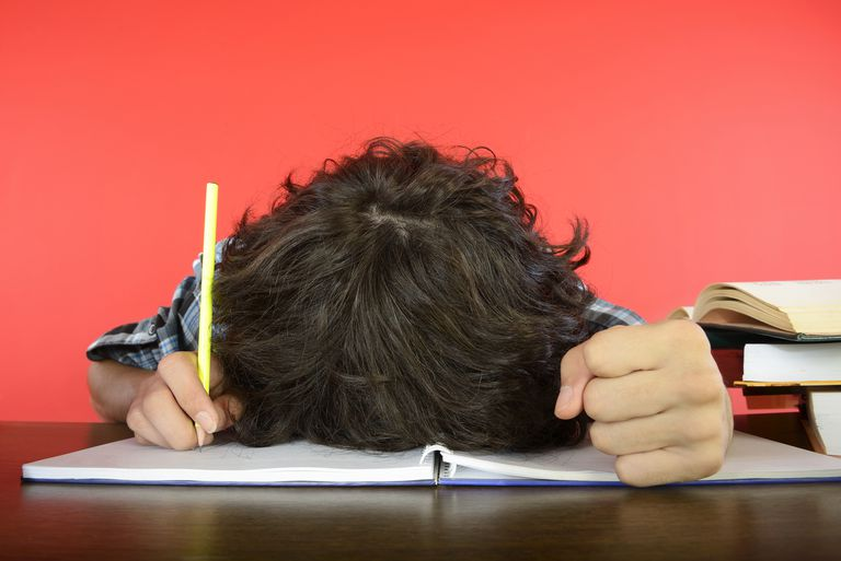 Student with Head on Notebook