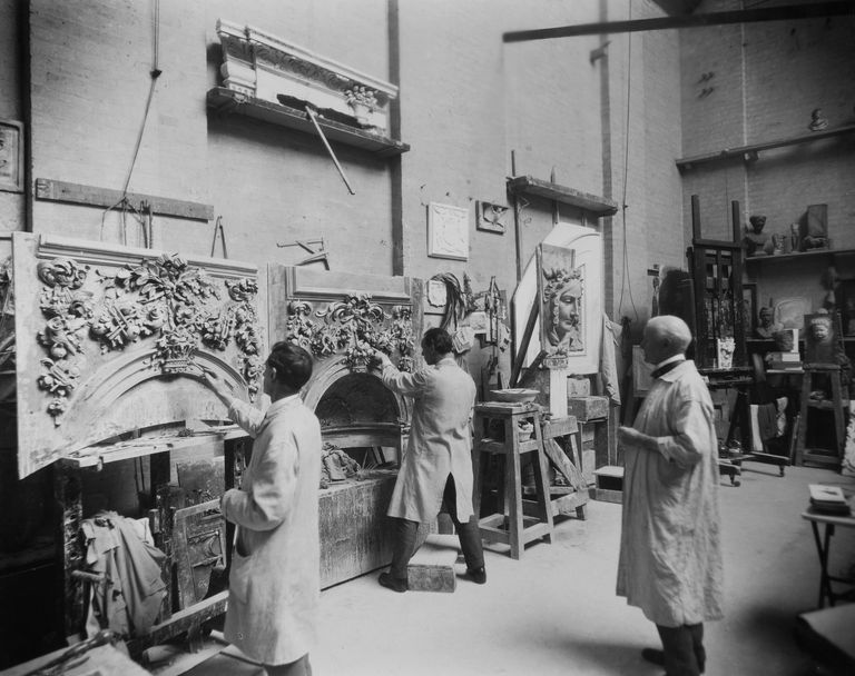 6th June 1928: Sculptor W B Fagan supervises his assistants as they work on a pair of ornamental fireplaces in his studio.