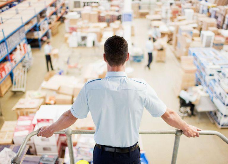 Supervisor monitoring shipping work