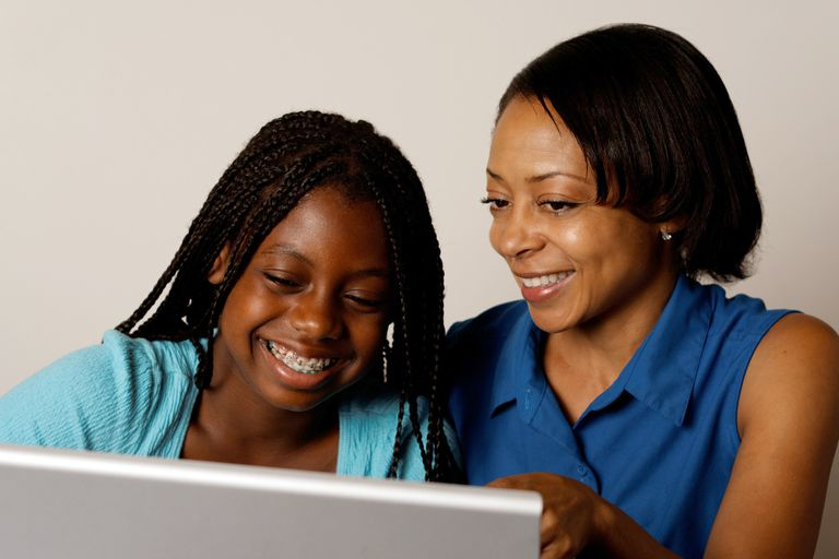 mother and daughter looking at computer
