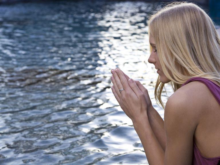 woman praying water