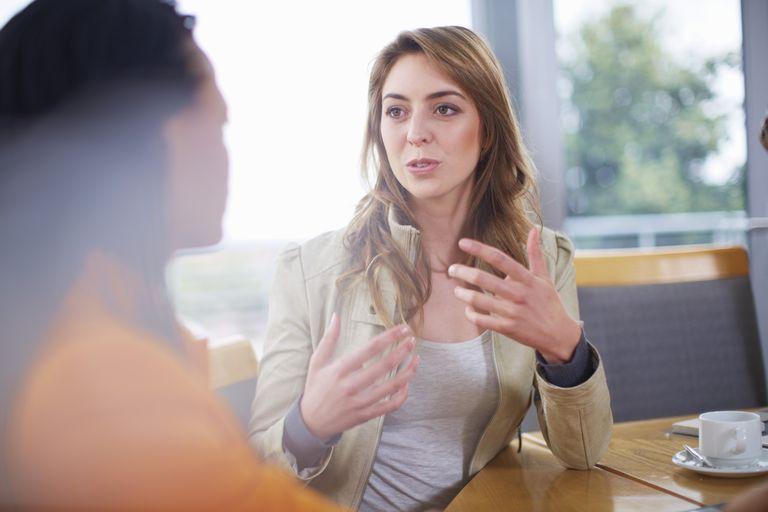 Portrait of businesswoman explaning something