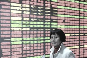 Woman in front of Chinese stock market