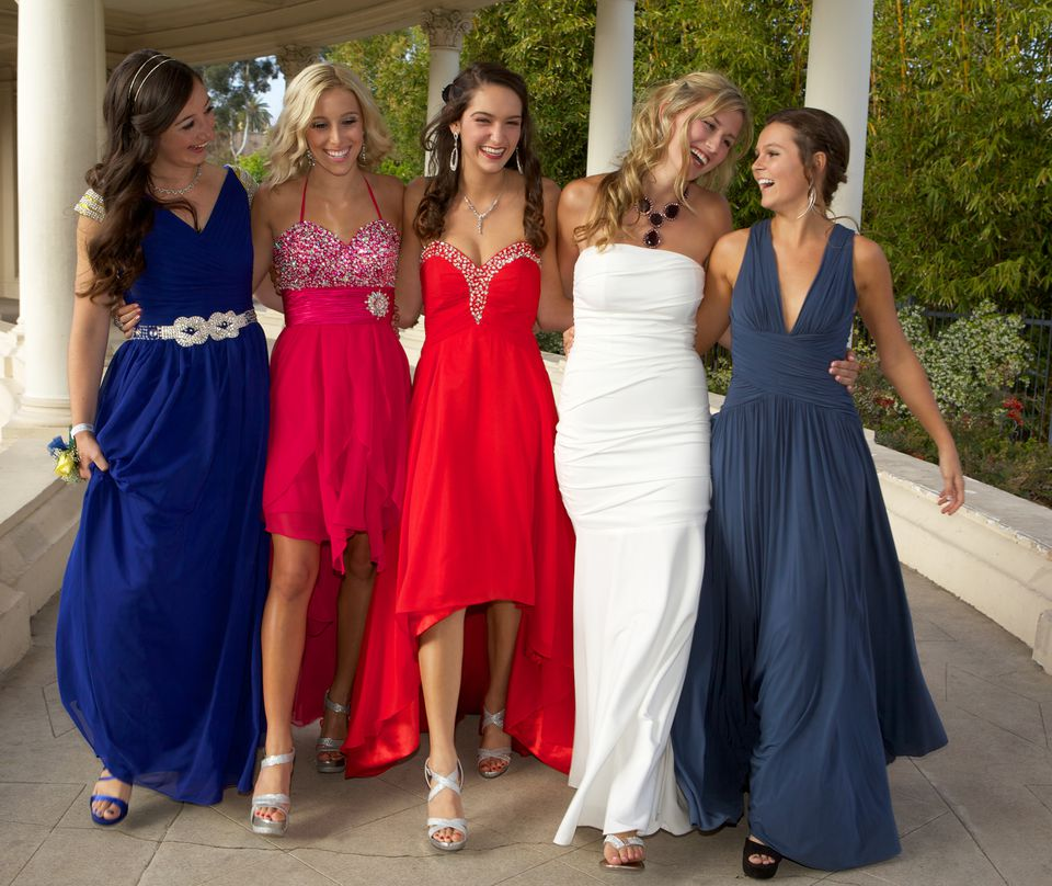 Teenage Girls Dressed for the Prom Walking and Having Fun