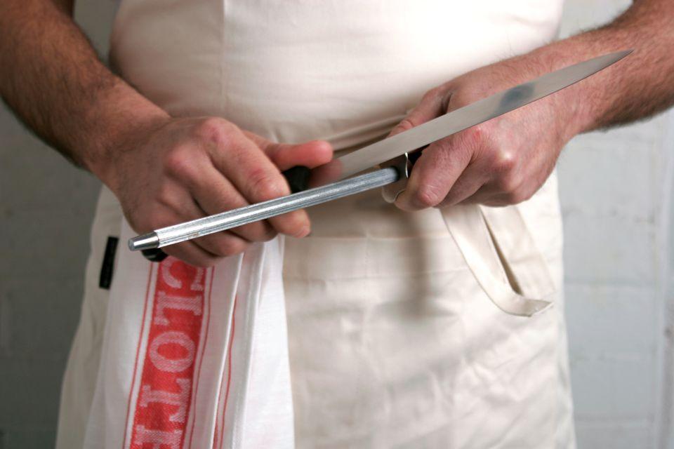 Man sharpening a knife