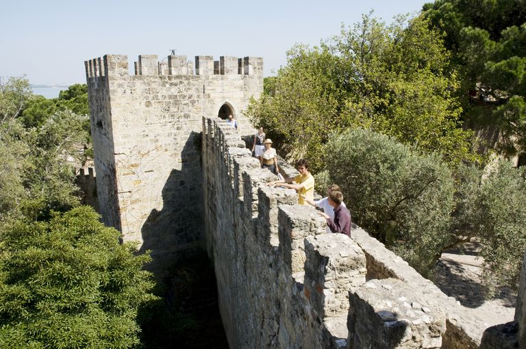 Tourists examine the battlements on the Moorish Castle of São Jorge, in Lisbon, Portugal