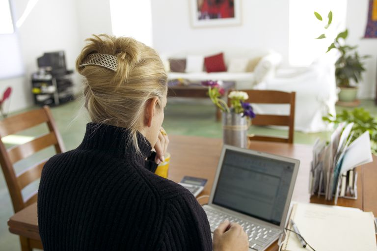 woman typing on laptop in home