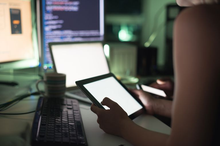 woman programming on computer