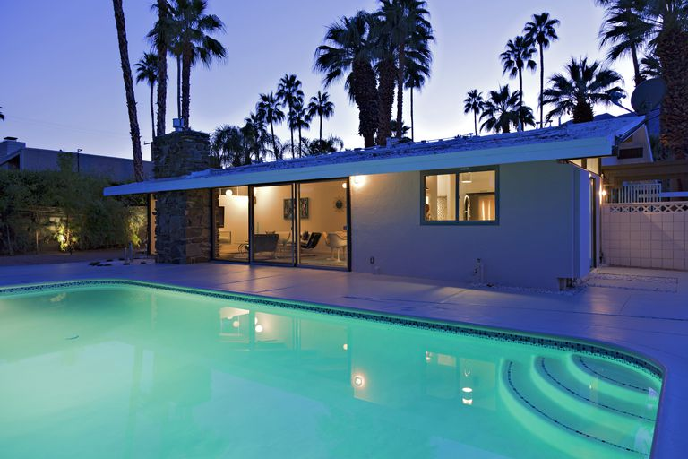 Night view of swimming pool mid-century modern