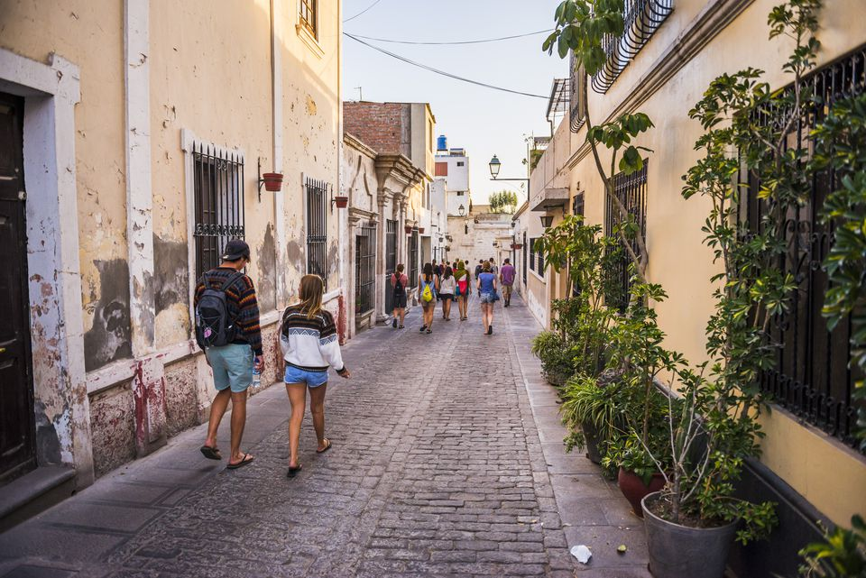 Backpackers walking in Arequipa, Peru