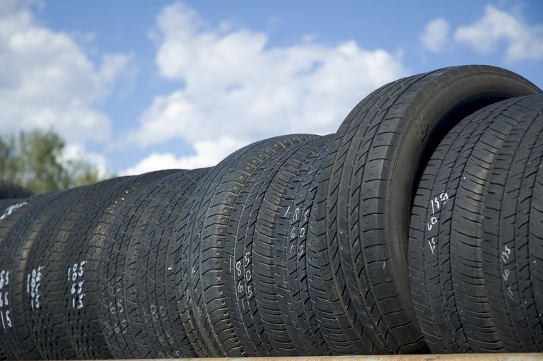a perspective view of a rack of used tires ready for sale