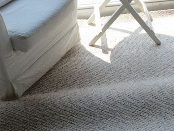 How To Lay An Area Rug Over Carpet