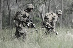 ROCKHAMPTON, AUSTRALIA - JULY 31: Two U.S Marines from Golf Company Battalion Landing Team (BLT) 2/4 run into position whilst participating in a live fire excercise on July 31, 2013 near Rockhampton, Australia.