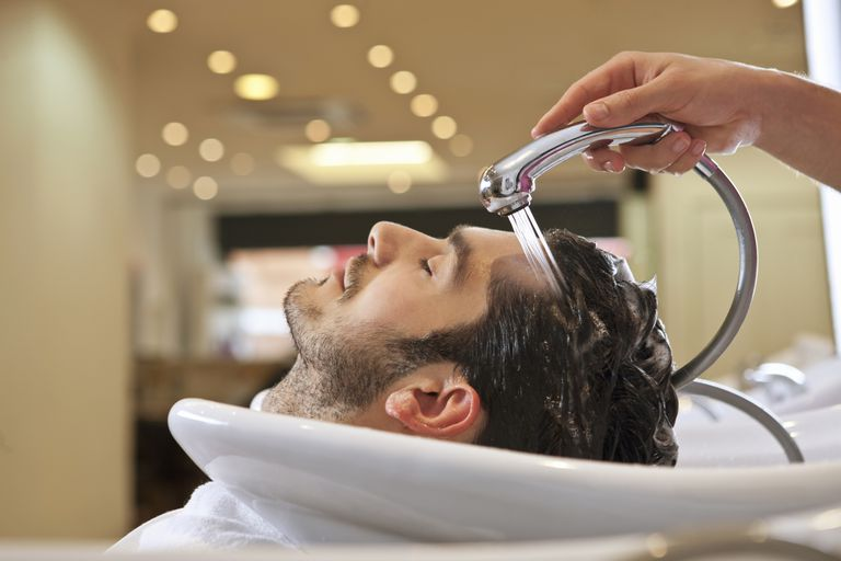 Man having hair washed in salon