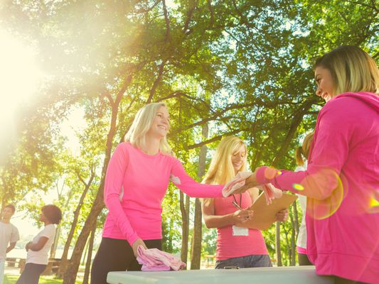 Women wearing pink, signing up for breast cancer charity race