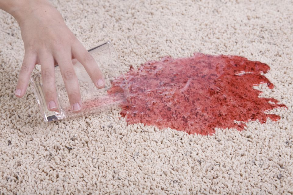 Red juice spill on carpet