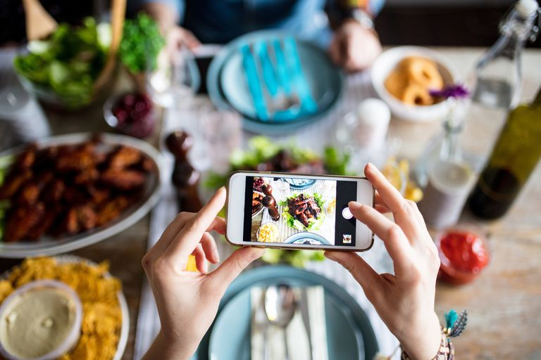 Woman taking photo of meal