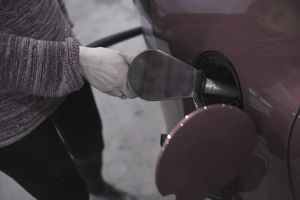 Woman´s hand pumping gas