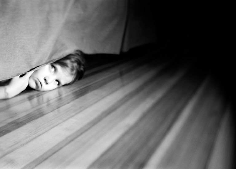 Child Hiding Underneath Bed