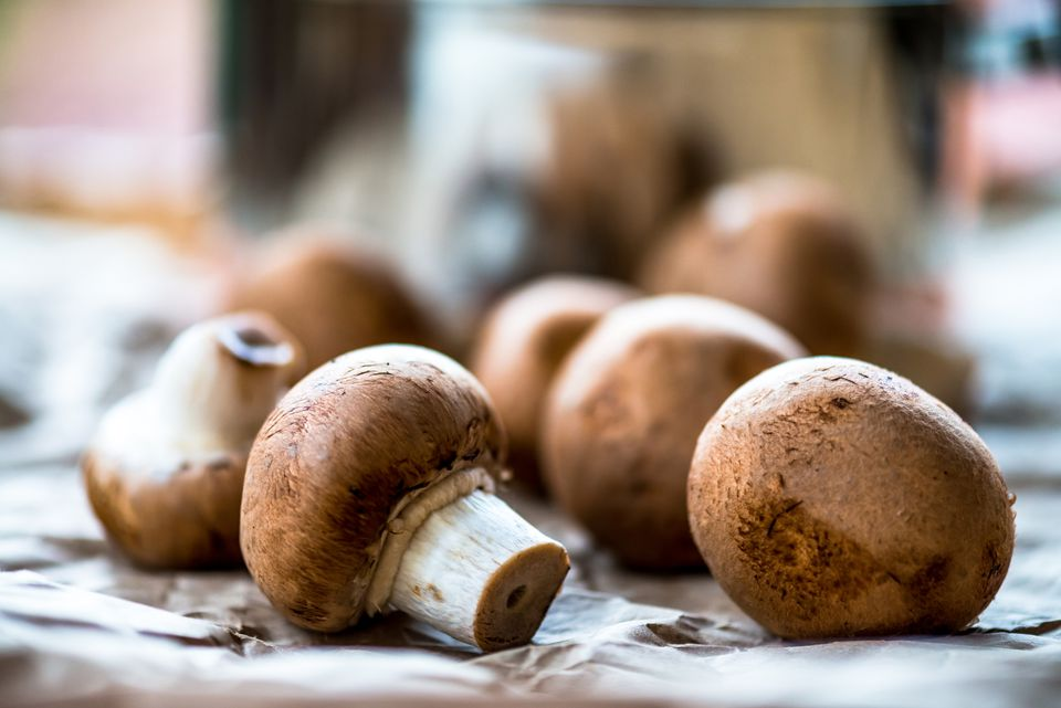 Cremini mushrooms and a cooking pot