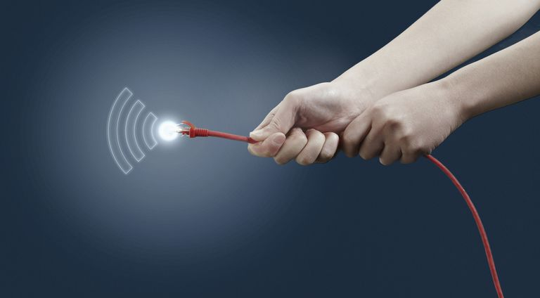 A pair of hands holding a red CAT5 Ethernet cable with a glowing connector