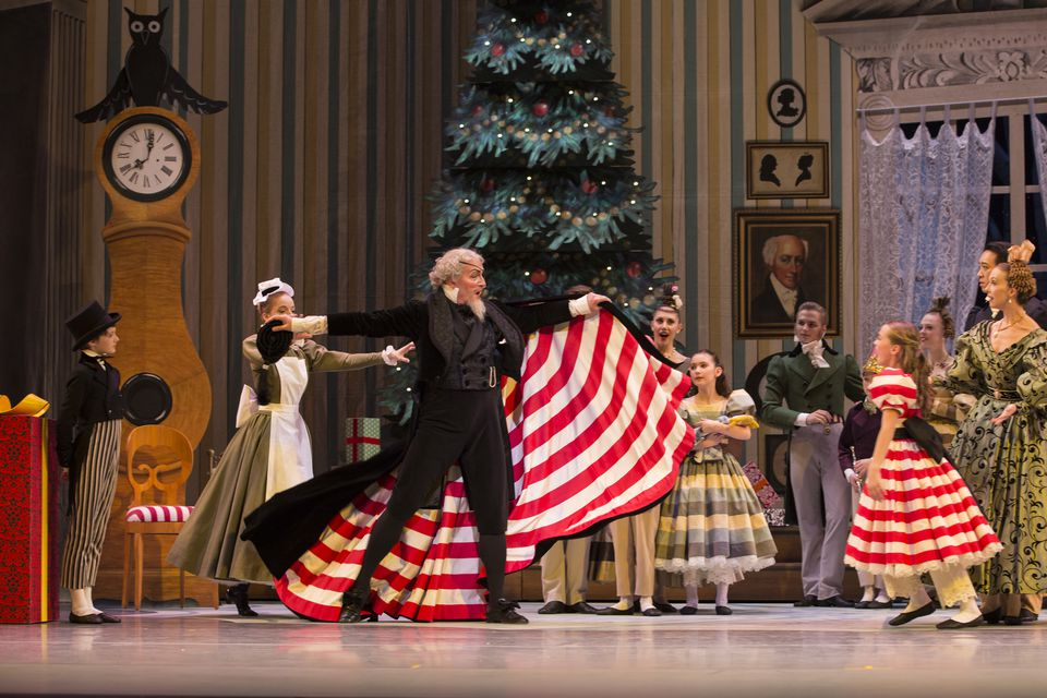 Pacific Northwest Ballet guest artist Uko Gorter as Drosselmeier and PNB School student Isabelle Rookstool as Clara in George Balanchine's The Nutcracker™. PNB's production features all new sets and costumes designed by children's author and illustrator Ian Falconer (Olivia the Pig) and runs November 27 – December 28, 2015. Photo © Angela Sterling.