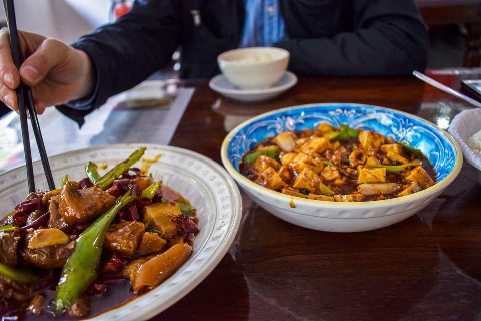 Hand Holding Chopsticks Picking Food