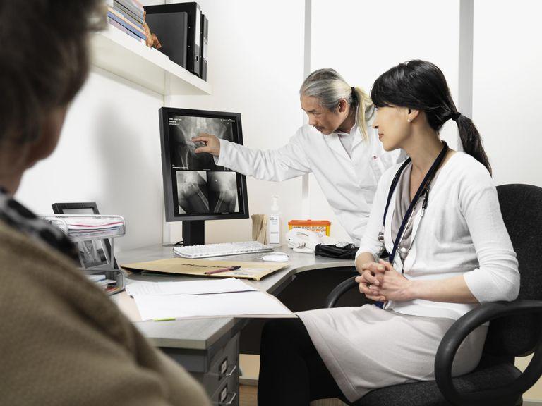 Doctors examining patients x-rays
