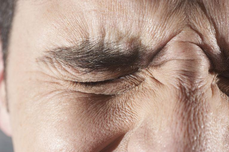 Close-up of man squinting his eyes