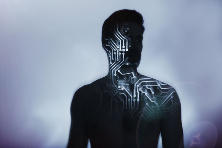Photo of a man's body with electronics overlaid on him