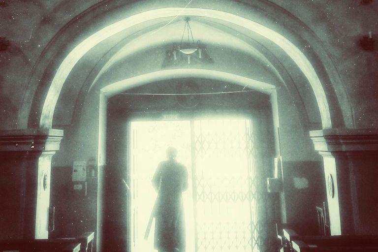 Priest leaving church
